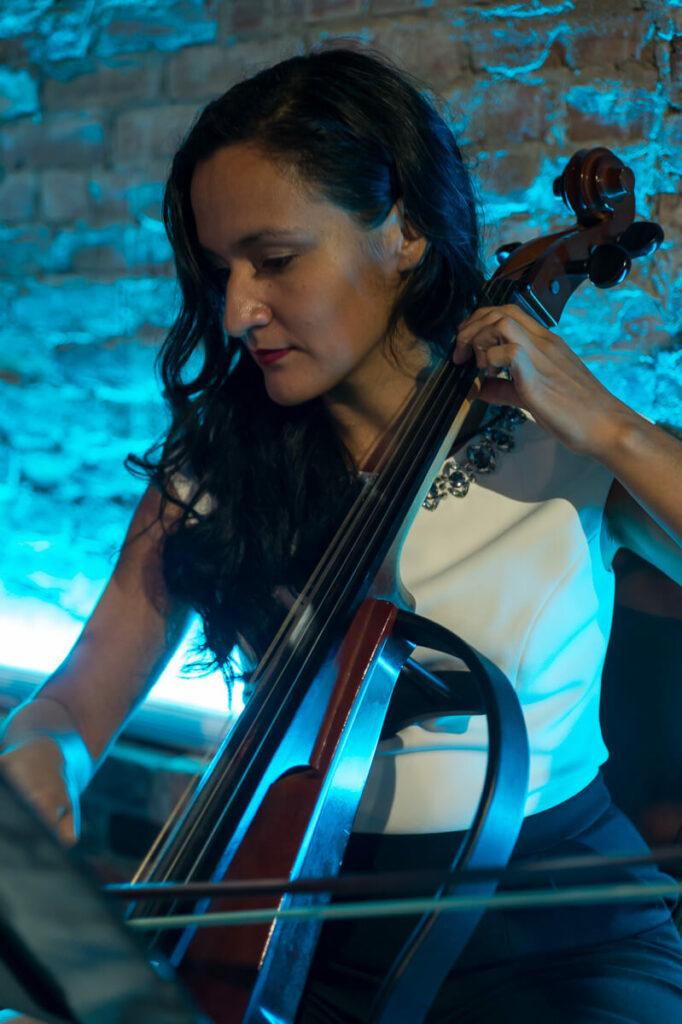 female electric cello player