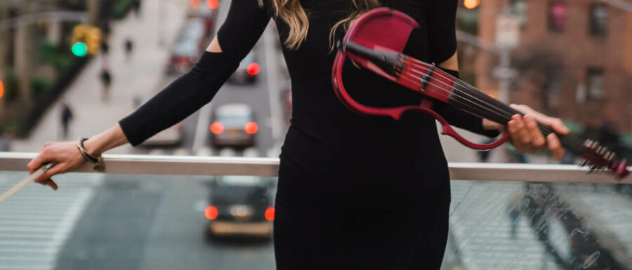 Electric Violinist Sarah with her pink violin at New York Highline