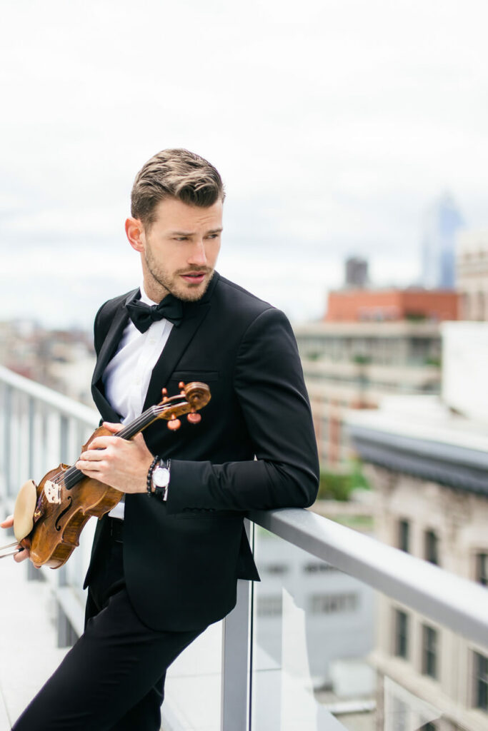 Violinist Filip on the rooftop in Flatiron District NYC photo by Jan Freire